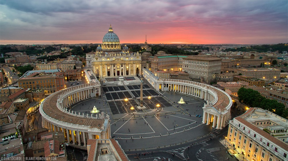 A spectacular view from above, as the sky lights up behind The Vatican in Rome.