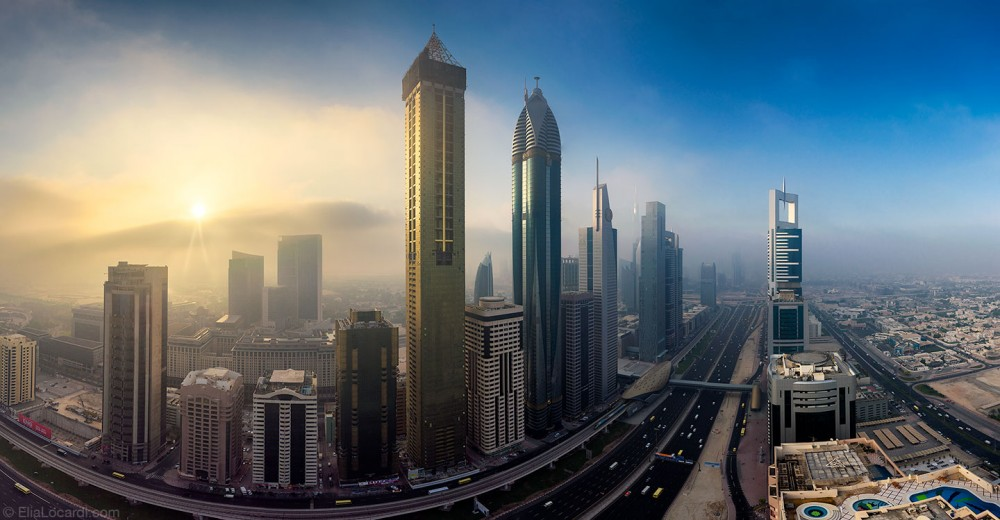 Patchy morning fog begins to engulf the extraordinary cityscape of downtown Dubai.