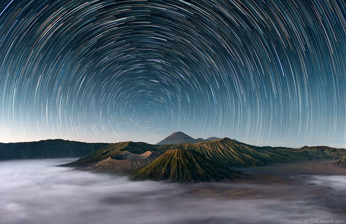 The stars dance above the extraordinary Mt Bromo Indonesia as the morning fog rolls through the caldera.