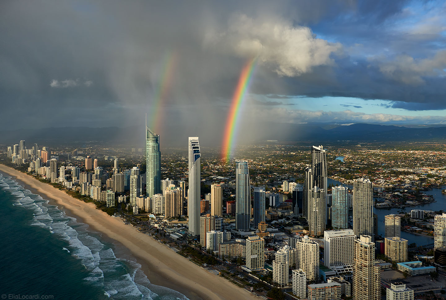 (A double rainbow appears over Surfers Paradise in Queensland Australia.)