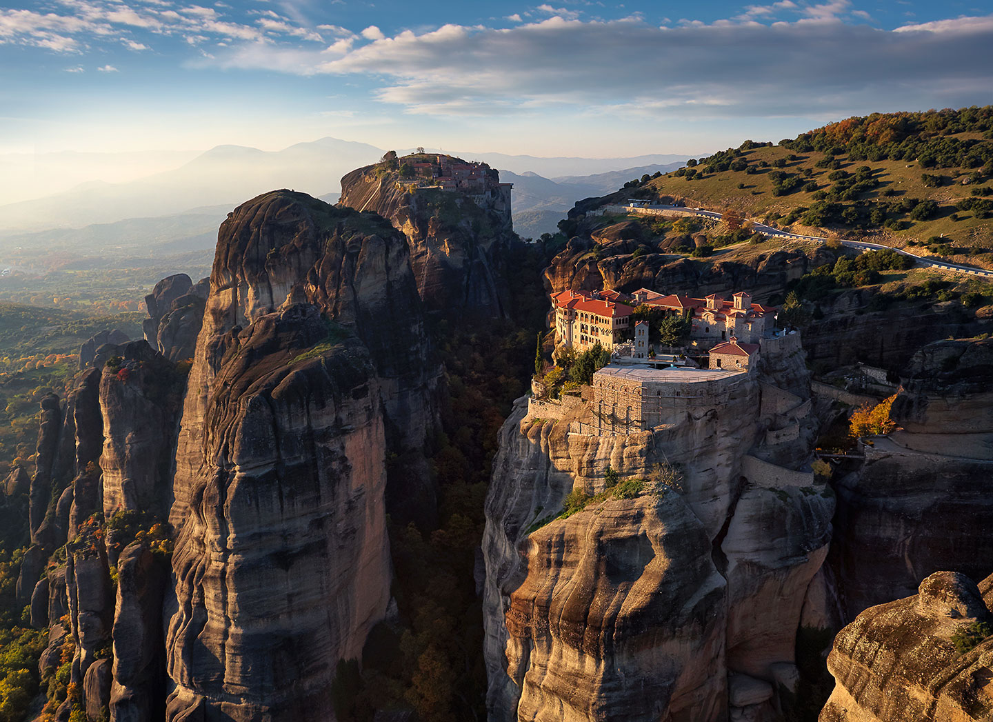 (Watching a beautiful sunset high above the monasteries of Meteora Greece.)
